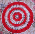 Bromley, Mary.  A circular Christmas doily made by Mary Bromley, Conche, Newfoundland.