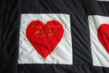 Lewis, Myrtle.  Close-up of a heart themed family tree quilt made by Myrtle Lewis, Roddickton.