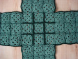Tucker, Clara.  A dark green crocheted pot holder made by Clara Tucker, St. Anthony.