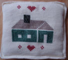 Tucker, Clara.  Cross-stitched wool house pillow made by Clara Tucker, St. Anthony.