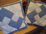 Tucker, Clara.  Two windmill patterned pillows made by Clara Tucker, St. Anthony.