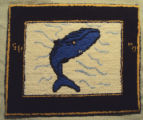 Wells, Dale.  A whale themed hooked mat made by Dale Wells, St. Anthony.