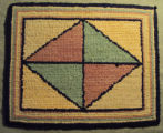 Wells, Dale.  A pink and green diamond patterend hooked mat made by Dale Wells, St. Anthony.