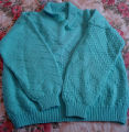 Bromley, Mary. A green knitted sweater made by Mary Bromley, Conche, Newfoundland.