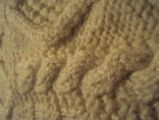 Wells, Dale.  Close-up of a knitted sweater made by Dale Wells' sister, St. Anthony.