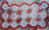 Bromley, Mary. A Christmas table runner crocheted by Mary Bromley, Conche, Newfoundland.
