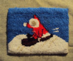 Wells, Dale.  A sledding themed hooked mat coaster made by Dale Wells, St. Anthony.