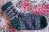 Bromley, Mary. One striped sock from a pair made by Mary Bromely, Conche, Newfoundland.