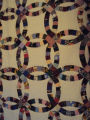 Wells, Dale.  A double wedding band quilt made by Dale Wells, St. Anthony.