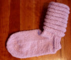 Bussey, Mary.  A pair of pink slouch socks knitted by Mary Bussey, St. Lunaire-Griquet.