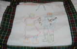 Bussey, Winnie. An embroidered image of mummers from a Newfoundland quilt, St. Lunaire-Griquet.