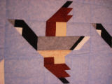 Bussey, Louise.  Close-up of a patchwork Canada goose quilt made by Louise Bussey, St....