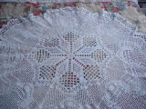 Bromley, Mary. A circular tablecloth made by Mary Bromley, Conche, Newfoundland.