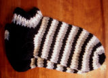 Bussey, Mary.  A pair of striped vamps knitted by Mary Bussey, St. Lunaire-Griquet.