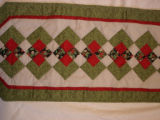 Bussey, Louise. Quilted Christmas themed table runner made by Louise Bussey, St. Lunaire-Griquet.