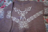 Bromley, Mary.  A knitted sweater with a deer head pattern made by Mary Bromley, Conche,...