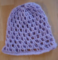 Bussey, Mary.  A purple crochet hat made by Mary Bussey, St. Lunaire-Griquet.