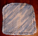 Bussey, Mary.  A dish cloth knitted by Mary Bussey, St. Lunaire-Griquet.
