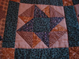Dower, Alice.  Close-up of a patchwork quilt made by Alice Dower, Conche, Newfoundland.