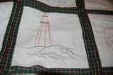 Bussey, Winnie.  An embroidered image of a lighthouse from a Newfoundland quilt, St....