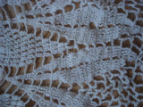 Bussey, Mary.  Close-up of a crochet table cloth made by Mary Bussey, St. Lunaire-Griquet.