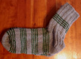 Bussey, Mary.  A pair of striped socks knitted by Mary Bussey, St. Lunaire-Griquet.