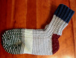 Bussey, Mary. A pair of socks knitted by Mary Bussey, St. Lunaire-Griquet.