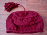 Myers, Annette.  Dark pink winter hat made by Annette Myers, Bird Cove.