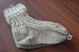 Myers, Annette.  Beige knitted socks made by Annette Myers, Bird Cove.