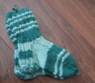 Myers, Annette.  Green knitted socks made by Annette Myers, Bird Cove.