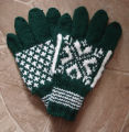 Simmonds, Mary Jane.  Traditional double-knit snowflake pattern gloves made by Mary Jane Simmonds,...