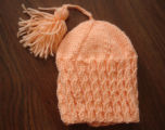 Myers, Annette.  Peach colored winter hat made by Annette Myers, Bird Cove.