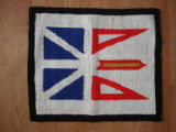 Dredge, Blanche.  A Newfoundland flag hooked mat made by Blanche Dredge, Black Duck Cove.