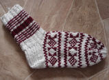 Simmonds, Mary Jane.  White and red patterned socks of Mary Jane Simmonds' own design, Conche,...