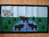 Dredge, Blanche.  A moose themed hooked mat made by Blanche Dredge, Black Duck Cove.