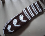 Kearney, Nellie.  Whale pattern double-knit sock made by Nellie Kearney, Conche, Newfoundland.