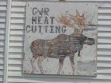 Dredge, Blanche.  'Meat Cutting' moose sign on the road along The Straights, Black Duck Cove.