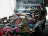 Dredge, Blanche.  Blanche Dredge stands next to her table of crafts in her home, Black Duck Cove.