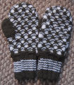 Simmonds, Mary Jane.  A pair of brown and white 'Newfie' mittens made by Mary Jane Simmonds,...