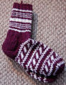 Simmonds, Mary Jane.  Burgundy and white patterned socks made by Mary Jane Simmonds, Conche,...