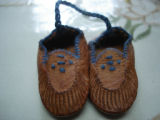 Noseworthy, Doreen.  Sealskin slipper ornament made by Doreen Noseworthy, Green Island Brook.