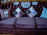 Parrill, Rita.  Handmade pillows on display in Rita Parrill's living room, Pines Cove.