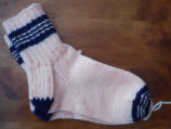 Dredge, Blanche.  White and blue socks made by Blanch Dredge, Black Duck Cove.