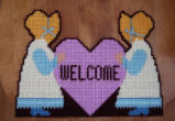 Dredge, Blanche.  'Welcome' sign in plastic canvas made by Blanche Dredge, Black Duck Cove.