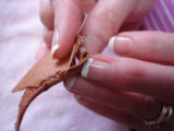 Noseworthy, Doreen.  Doreen Noseworthy demonstrates the kind of stitch used in making pleats for...