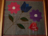 White, Eileen.  A hooked mat made by Eileen White's mother, Sandy Cove.