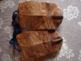 White, Eileen.  The backside of a pair of child sized sealskin boots belonging to Eileen White,...