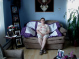 Genge, Eliza.  Eliza Genge poses in her livingroom with one of her embroidered quilts, Anchor...