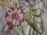 Genge, Eliza.  Close-up of floral embroidered pillow cases made by Eliza Genge, Anchor Point.