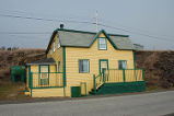 Simmonds, Mary Jane.  The house that Mary Jane Simmonds was raised in, Conche, Newfoundland.